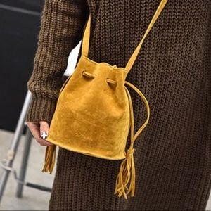 Handbags - Suede bucket tote with tassels!